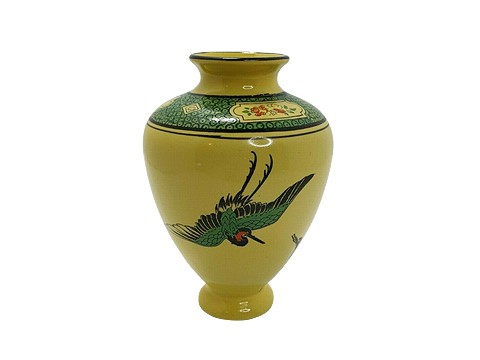 yellow vase with cranes